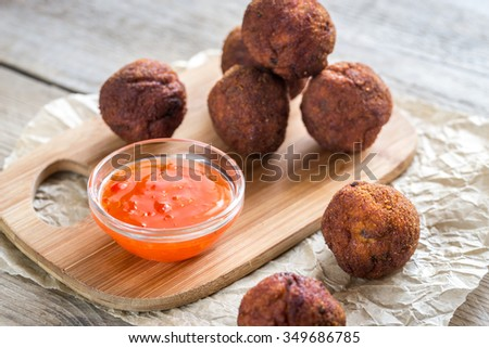 Chicken meatballs with spicy thai sauce - stock photo