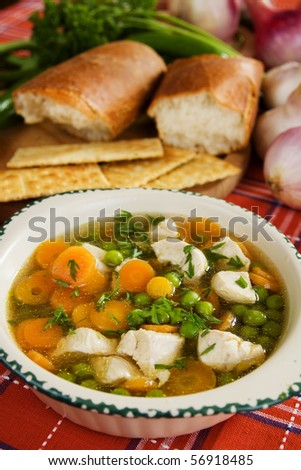 Chicken noodle soup with green peas and carrot