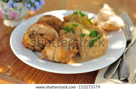 ... braised in apple cider with apple slices and onions - stock photo