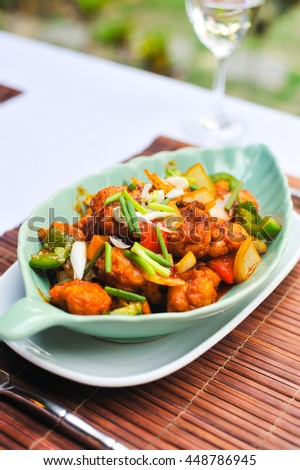 Chicken nugget mix cashew nut and vegetable in beautiful blow on table food, Thai style