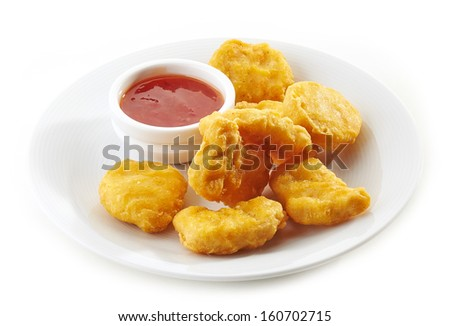 chicken nuggets and sauce on white plate - stock photo