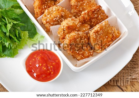 Chicken nuggets coated in cereals, crumbs and sesame - stock photo