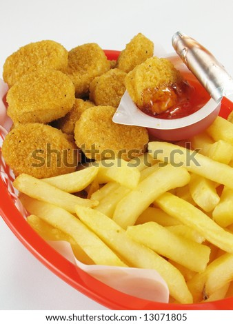 Chicken nuggets & fries with sweet and sour sauce. - stock photo