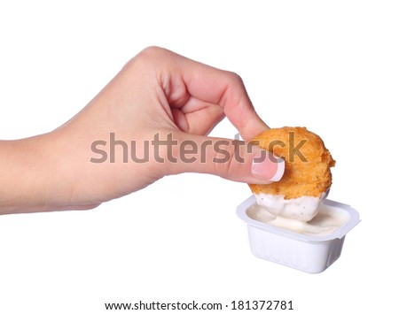 Chicken Nuggets in female hand and mayo isolated on white - stock photo