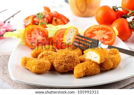 Chicken nuggets on dish on complex background - stock photo