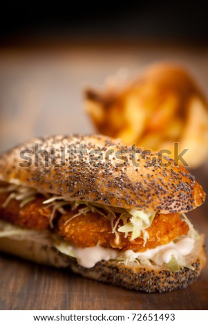 Chicken nuggets sandwich and french fries - stock photo
