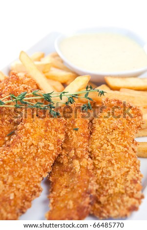 Chicken nuggets with french fries and yogurt sauce, shallow dof, selective focus - stock photo