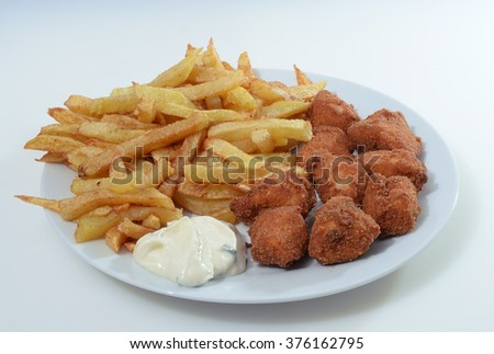 chicken nuggets with fries and white dip - stock photo