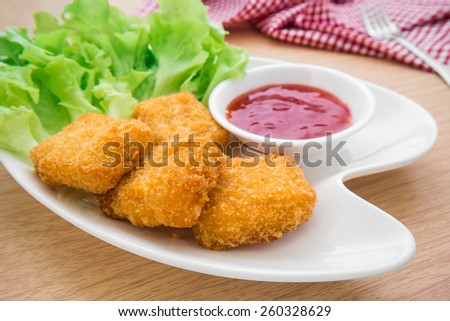 Chicken nuggets with ketchup on plate   - stock photo