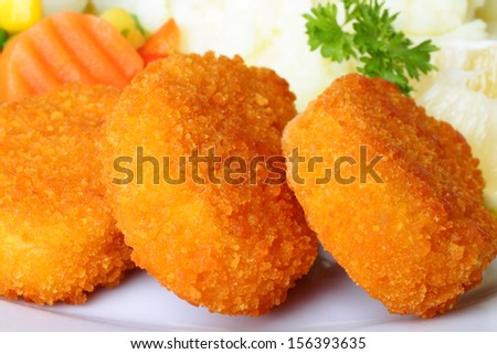 Chicken nuggets with mashed potatoes and vegetables - stock photo