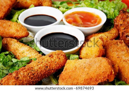 chicken nuggets with sauce and lettuce - stock photo