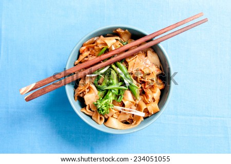 chicken pad see ew, a thailand tradition - stock photo