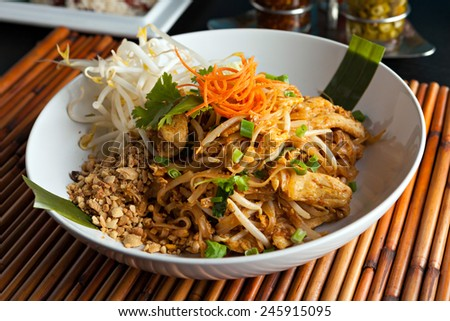 Chicken pad Thai dish of stir fried rice noodles with a contemporary presentation - stock photo