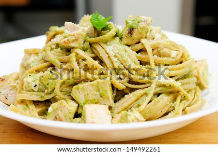 chicken pesto pasta with basil and parmesan cheese - stock photo
