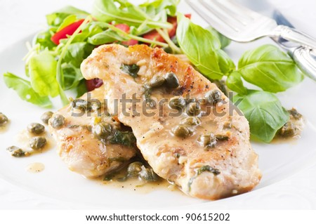 Chicken Piccata with capern and white wine sauce - stock photo