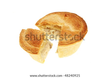 Chicken pie with a slice cut out isolated on white - stock photo