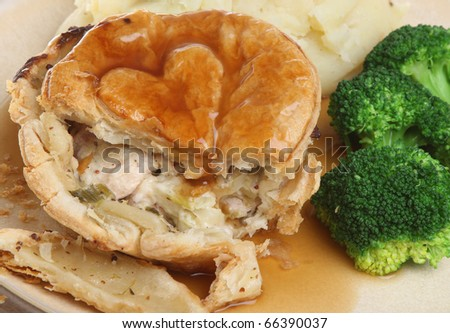 Chicken pie with mashed potato and broccoli. - stock photo