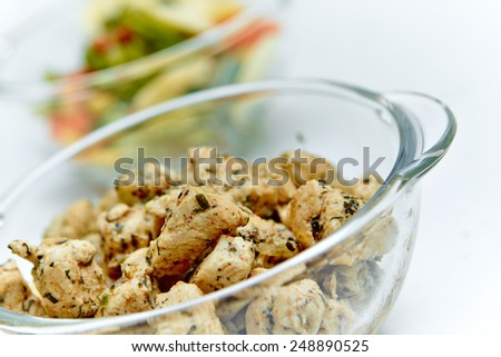 Chicken pieces in a bowl - stock photo