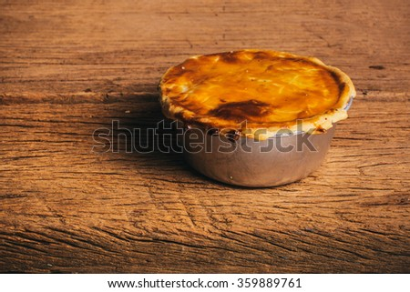 Chicken Pot Pie, Delicious. Homemade Fresh Baked, Country Rustic Style. Wood Background. Selective Focus. - stock photo