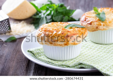 Chicken pot pie with cheese and basil on rustic wooden table - stock photo