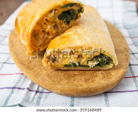 Chicken roll stuffed with spinach and cheese