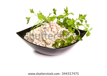Chicken salad in a black bowl