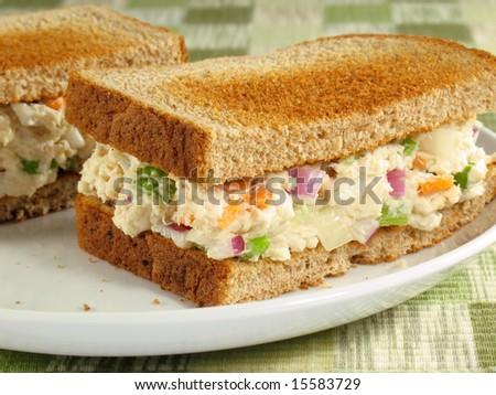 Chicken salad on toasted wheat bread. - stock photo