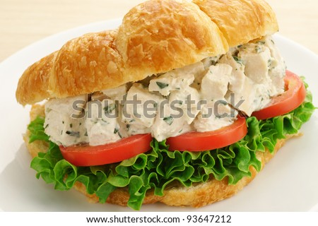 Chicken Salad Sandwich with Lettuce and Tomato on a Croissant - stock photo