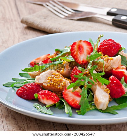 Chicken salad with arugula and strawberries - stock photo