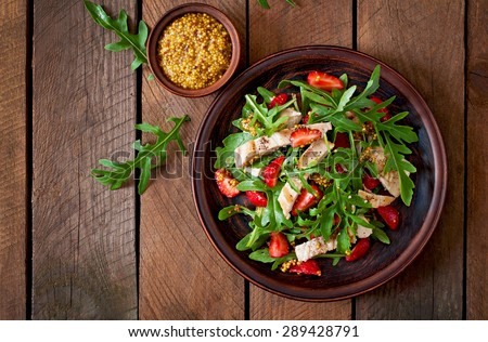 Chicken salad with arugula and strawberries. Top view - stock photo