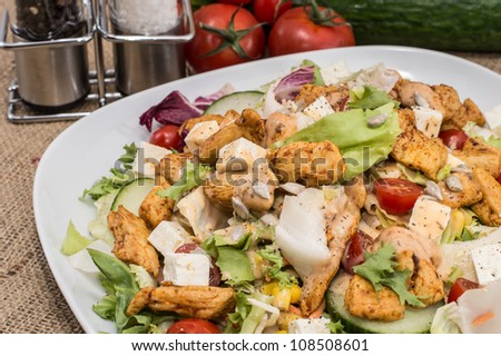Chicken Salad with cheese and ingredients on rustic background - stock photo