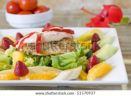 Chicken salad with dressing and fruit - stock photo
