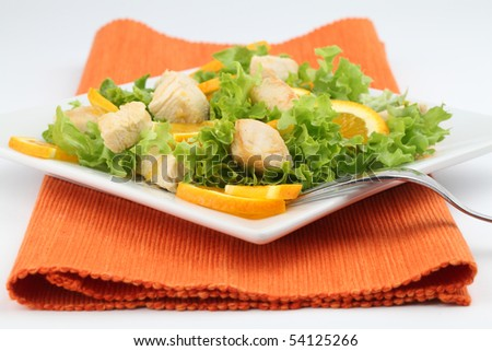 Chicken salad with fresh lettuce and oranges