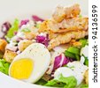 Chicken salad with green beans, cooked egg and cream in a white bowl - stock photo