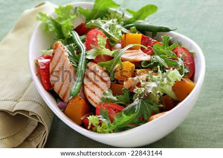 Chicken salad with roasted vegetables and mixed greens.  Delicious healthy eating. - stock photo