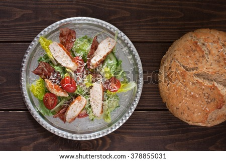 Chicken salad with tomatoes and homemade bread - stock photo