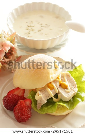 Chicken sandwich and clam chowder for gourmet breakfast image
