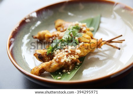 chicken satay, sate ayam and lontong with peanut sauce