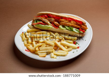 Chicken schnitzel sandwich with  french fries - stock photo
