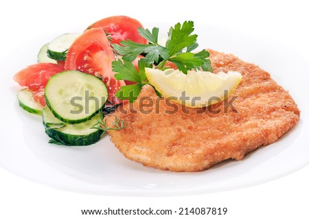 Chicken schnitzel with vegetable salad on white plate, isolated on white background - stock photo
