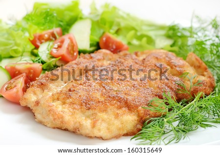 Chicken schnitzel with vegetables and herbs. - stock photo