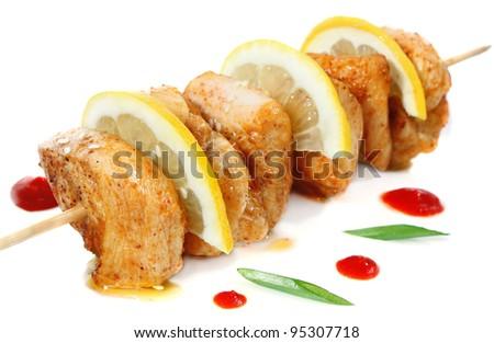 chicken shish kebab with lemon isolated on white background - stock photo
