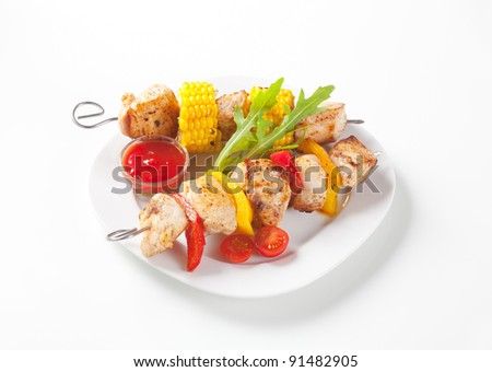 Chicken Shish kebabs and bowl of dipping sauce