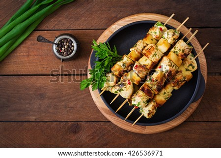Chicken skewers with slices of apples and chili. Top view - stock photo