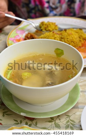 chicken soup and Muslim yellow rice with chicken