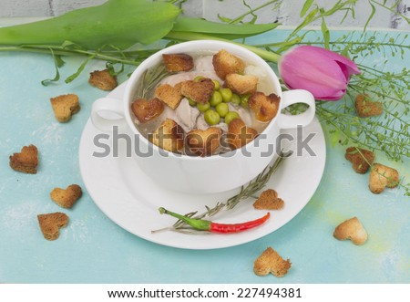 Chicken soup croutons heart tableware tulip flower spring plate tenderness - stock photo