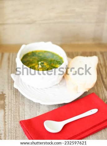 Chicken soup on the wooden - stock photo