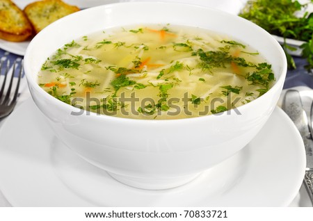 Chicken  Soup with handmade noodles. - stock photo