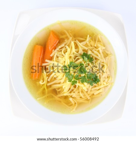 Chicken soup with macaroni and carrots decorated with parsley - stock ...