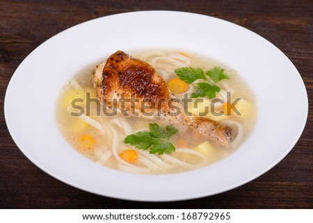 Chicken soup with noodle and vegetables  - stock photo